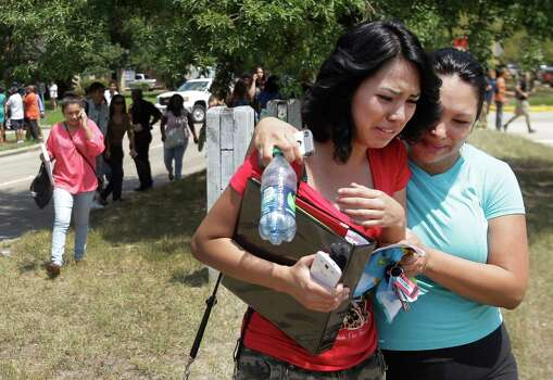 Alexa Martinez, a senior, and her mother, Cynthia Fielder leave after students were released from Spring High School where a student was fatally stabbed and three others injured Wednesday, Sept. 4, 2013, in Spring. Photo: Melissa Phillip, Houston Chronicle / © 2013  Houston Chronicle