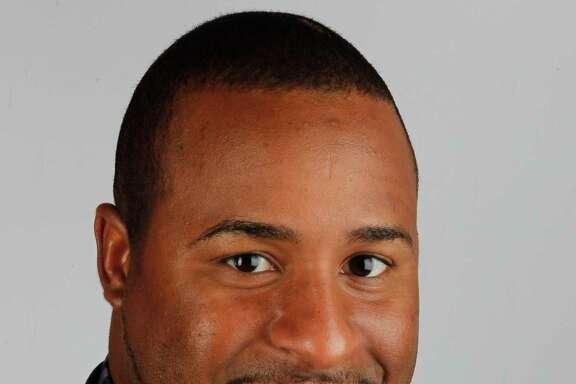 Houston Chronicle editorial employee Angel Verdejo Thursday, July 12, 2012, in Houston.  ( James Nielsen / Chronicle )