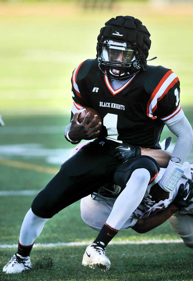 Stamford quarterback Jalen Brown breaks a tackle during their preseason football scrimmage against Bethel at Stamford High School on Wednesday, Sept. 4, 2013. Photo: Jason Rearick / Stamford Advocate