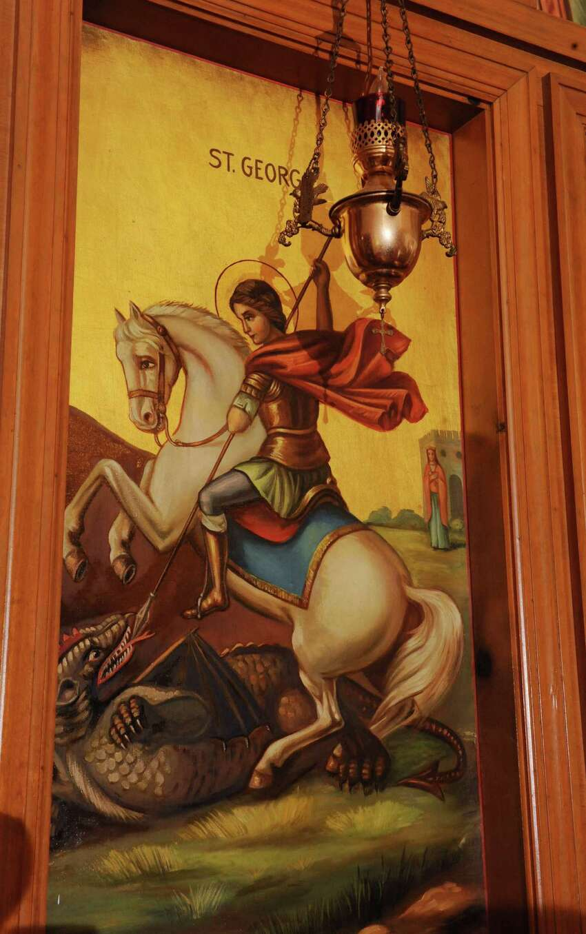 Panel of St. George attacking a dragon in the Alter at St. George Antiochian Orthodox church Tuesday afternoon, Sept. 3, 2013, in Albany, N.Y. The church was built 80 years ago by Syrian immigrants who settled in city's South End. (Lori Van Buren / Times Union)