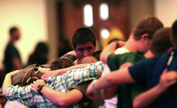 Spring High School students comfort one another at the vigil. Photo: Billy Smith II, Chronicle / © 2013 Houston Chronicle