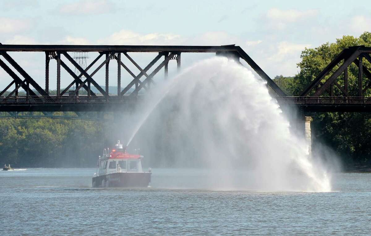 The new fire boat pumps water on the Hudson River was Christened today Sep 4, 2013, by Mayor Jerry Jennings in a ceremony held at Jenning's Landing in Albany, N.Y. The fire boat can pump 2000 of water per minute and can travel with the aid of two 300 horsepower motors at close to 45 miles per hour on water at full throttle. ( Skip Dickstein/Times Union )