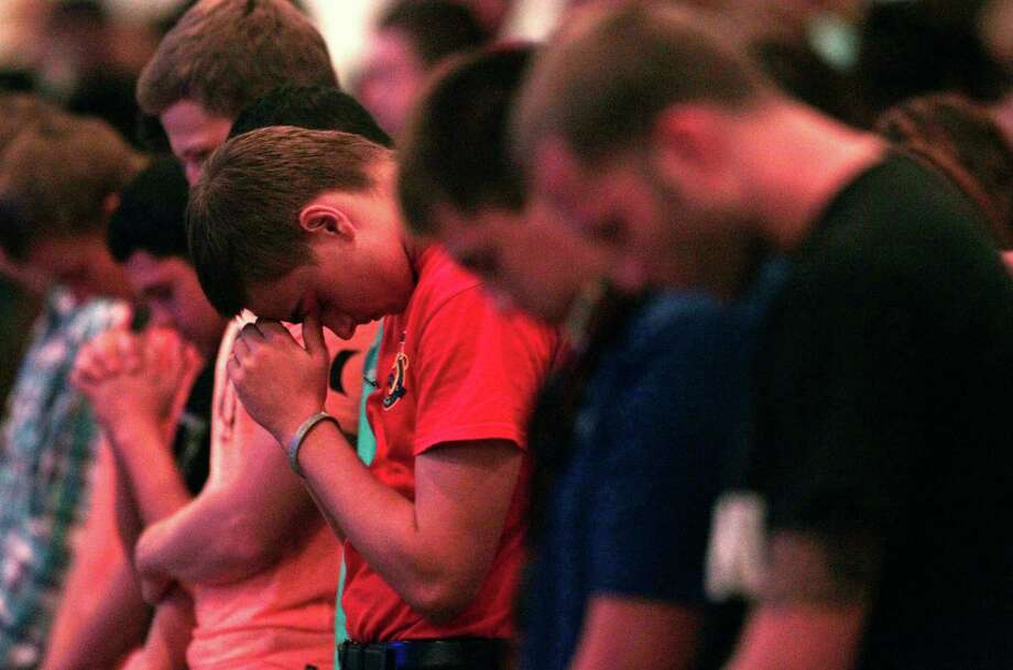 Spring High School student Zach Sckittone participates in a prayer vigil at Spring Baptist Church, Wednesday, Sept. 4, 2013, in Spring, Texas. Students and church members gathered for prayer after a stabbing death at Spring High school Wednesday morning. Photo: Billy Smith II, Chronicle / © 2013 Houston Chronicle