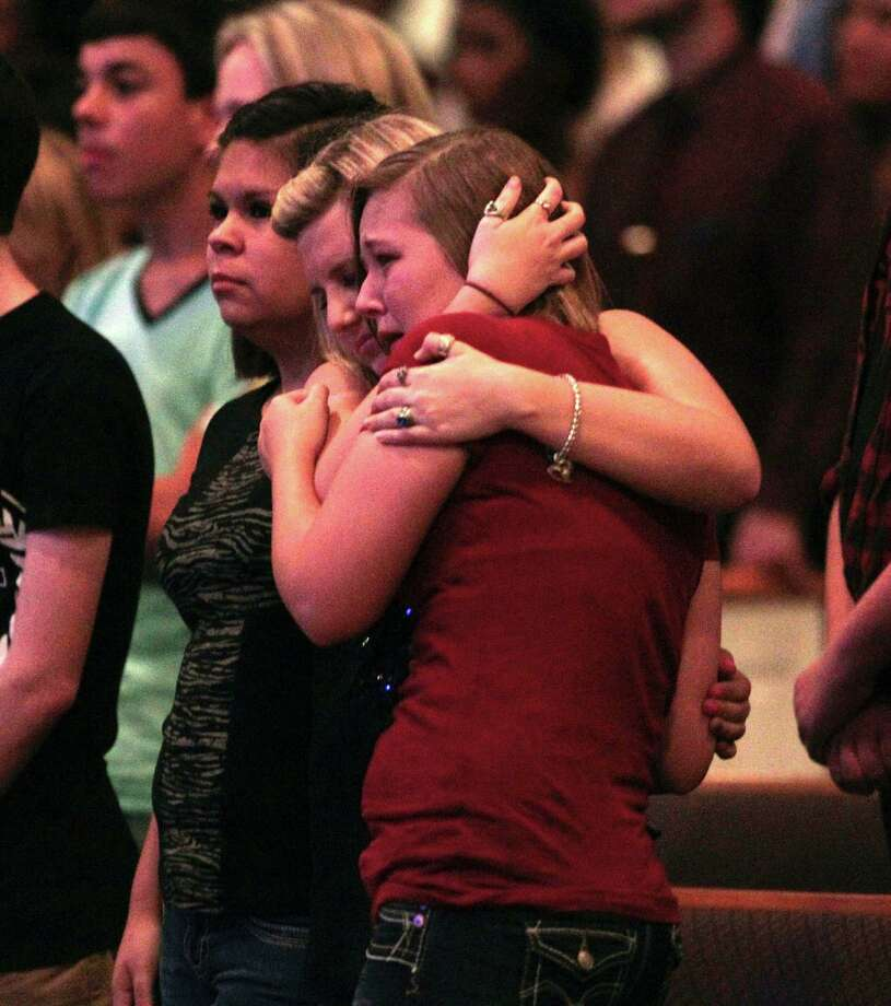 Spring High School students embrace during a prayer vigil at Spring Baptist Church, Wednesday, Sept. 4, 2013, in Spring, Texas. Students and church members gathered for prayer after a stabbing death at Spring High school Wednesday morning. Photo: Billy Smith II, Chronicle / © 2013 Houston Chronicle