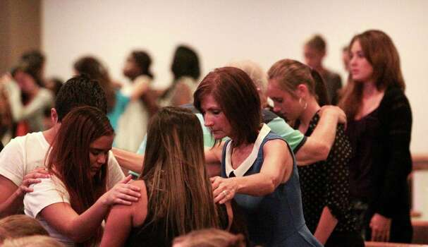 Spring High School students and church goers embrace during a prayer vigil at Spring Baptist Church, Wednesday, Sept. 4, 2013, in Spring, Texas. Students and church members gathered for prayer after a stabbing death at Spring High school Wednesday morning. Photo: Billy Smith II, Chronicle / © 2013 Houston Chronicle