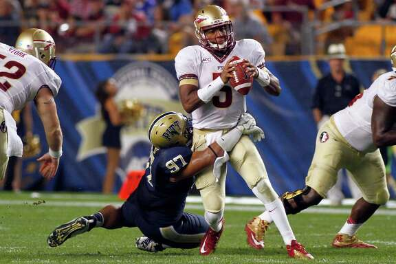 Florida State's Jameis Winston was dazzling in his collegiate debut against Pittsburgh on Monday night, completing 25 of 27 passes for 356 yards.