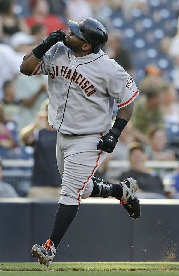 San Francisco Giants' Pablo Sandoval kisses his hands while rounding third base after hitting his second home run of the game against the San Diego Padres during the eighth inning in a baseball game Wednesday, Sept. 4, 2013, in San Diego. (AP Photo/Gregory Bull) Photo: Gregory Bull, Associated Press