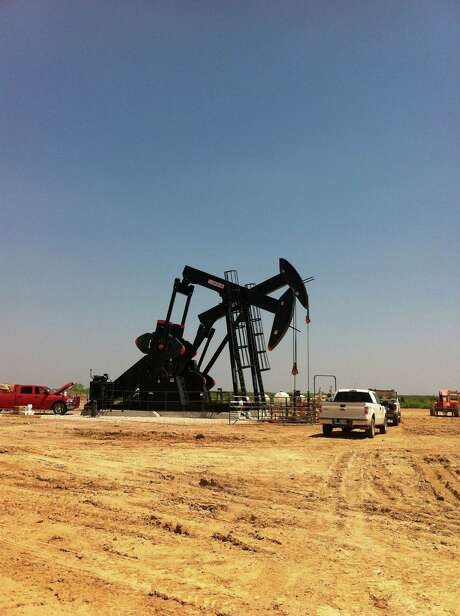 Pumping units draw from a well in Texas' Eagle Ford Shale, where a new government report predicts daily production will drop by almost 70,950 barrels next month..  (Carrizo Oil & Gas photo) Photo: Carrizo Oil & Gas
