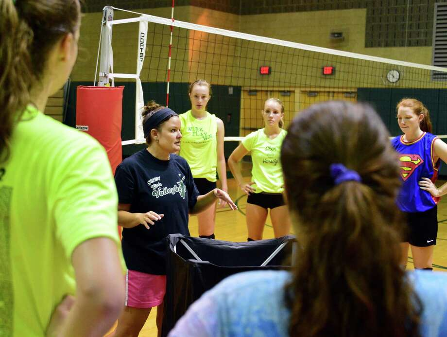 Varsity head coach Lori Kessler, second from left, with players during Shenendehowa girls' volleyball practice Thursday Aug. 29, 2013, in Clifton Park, NY.  (John Carl D'Annibale / Times Union) Photo: John Carl D'Annibale / 00023678A