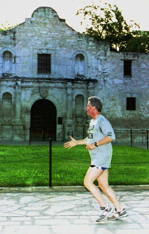 Democratic presidential candidate Bill Clinton jogs near the Alamo, Aug. 27, 1992, during a morning run. Clinton later addressed a rally on the banks of the San Antonio river.  Photo: LUKE FRAZZA, AFP / Getty Images / AFP