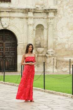 """""""Top Chef"""" host Padma Lakshmi poses in front of the Alamo on June 28, 2011, for a Season 9 episode of the show. Photo: Virginia Sherwood, NBCU Photo Bank Via Getty Images / © NBCUniversal, Inc."""