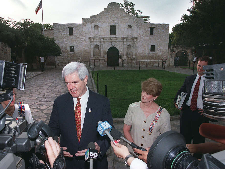 Speaker of the House Newt Gingrich speaks with the media after his tour of the Alamo on July 1, 1998. Photo: KIN MAN HUI, San Antonio Express-News / SAN ANTONIO EXPRESS-NEWS