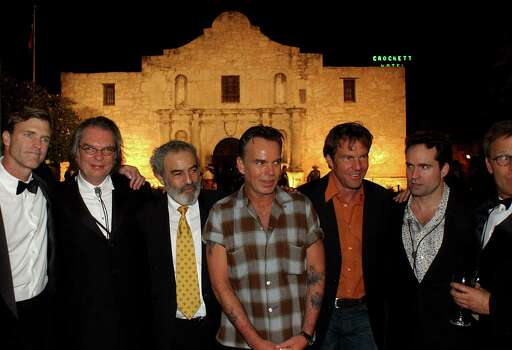 """""""The Alamo"""" cast members (from left) John Lee Hancock, Leon Rippy, Emilio Echevarria, Billy Bob Thorton, Dennis Quaid, Jason Patric and Mark Johnson stand in front of the Alamo at the Disney Premiere After Party for the movie on March 27, 2004, in San Antonio. Photo: Jill Torrance, Getty Images / 2004 Getty Images"""