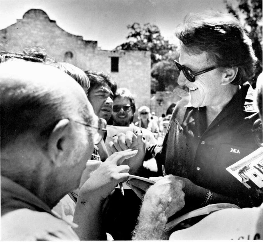 "James Arness talks to fans in front of the Alamo in this undated photo. He played Jim Bowie in the TV movie ""The Alamo: 13 Days to Glory."" Photo: San Antonio Express-News File Photo"