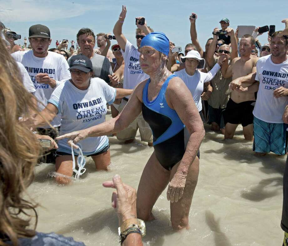 Diana Nyad emerges from the Atlantic Ocean after completing her swim from Cuba to Key West, Fla. Photo: Andy Newman / Florida Keys News Bureau