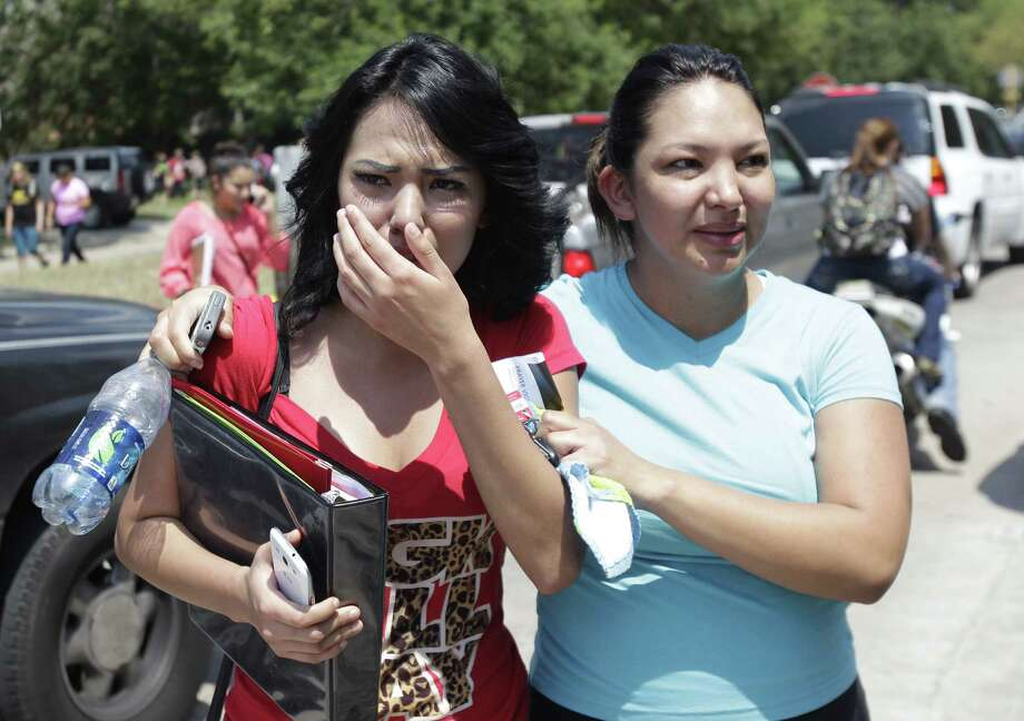 Alexa Martinez, a senior, and her mother, Cynthia Fielder, leave after students were released from Spring High School, where one person was killed and three were injured in a fight. Photo: Melissa Phillip / Houston Chronicle