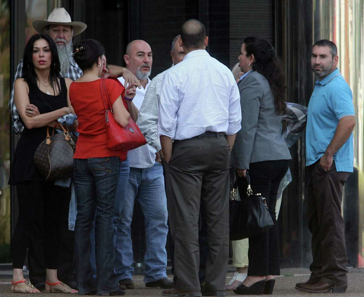People gather at the McAllen federal building for the hearing for Progreso Mayor Omar Vela, his brother and school board President Michael Vela, and their dad, Jose Guadalupe Vela Jr.
