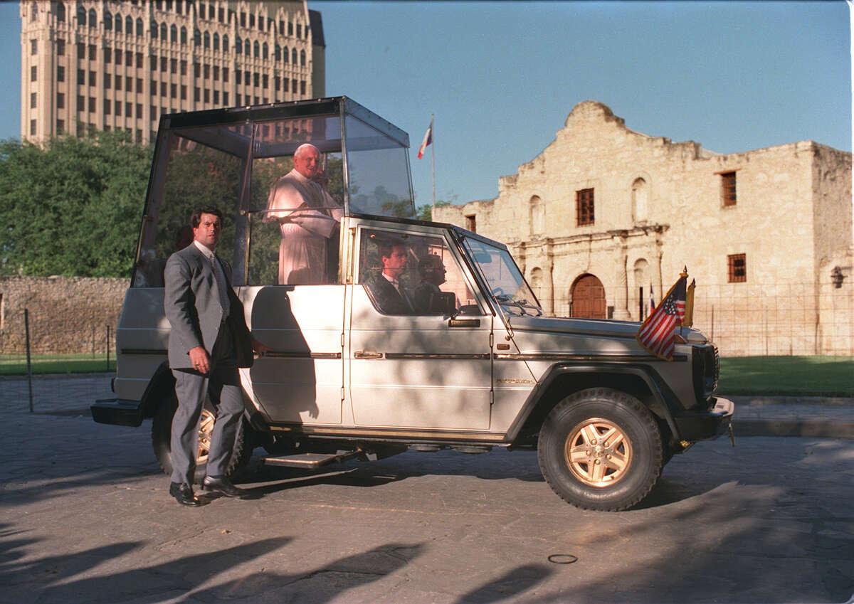 Pope John Paul II rides past the Alamo during his visit to San Antonio Sunday, Sept. 13, 1987.