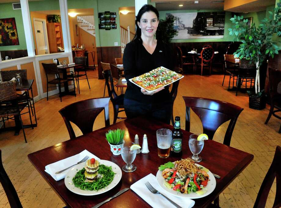 Julia Crisafi Michaelsen, who co-owns 59 Bank with her husband, Arthur Michaelsen Jr., in New Milford, Conn., holds a plate of chicken fajitas, Wednesday, Sept. 4, 2013. Photo: Michael Duffy / The News-Times