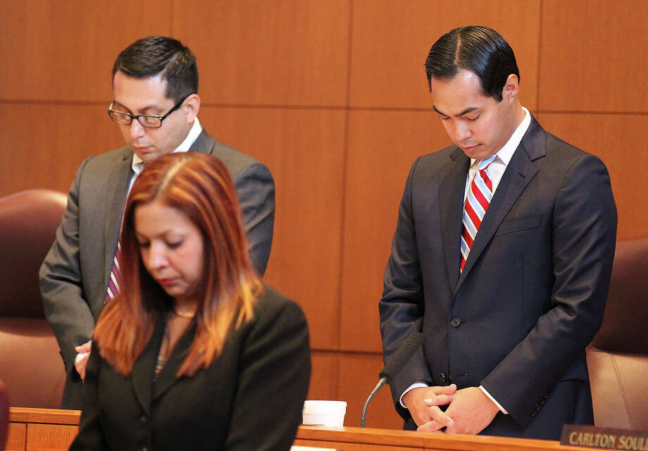 San Antonio Mayor Julian Castro, right, and Councilman Diego Bernal pray before a Sept. 5, 2013, session. The Supreme Court is likely to take up public prayer during this fall session. Photo: Kin Man Hui, San Antonio Express-News / ©2013 San Antonio Express-News
