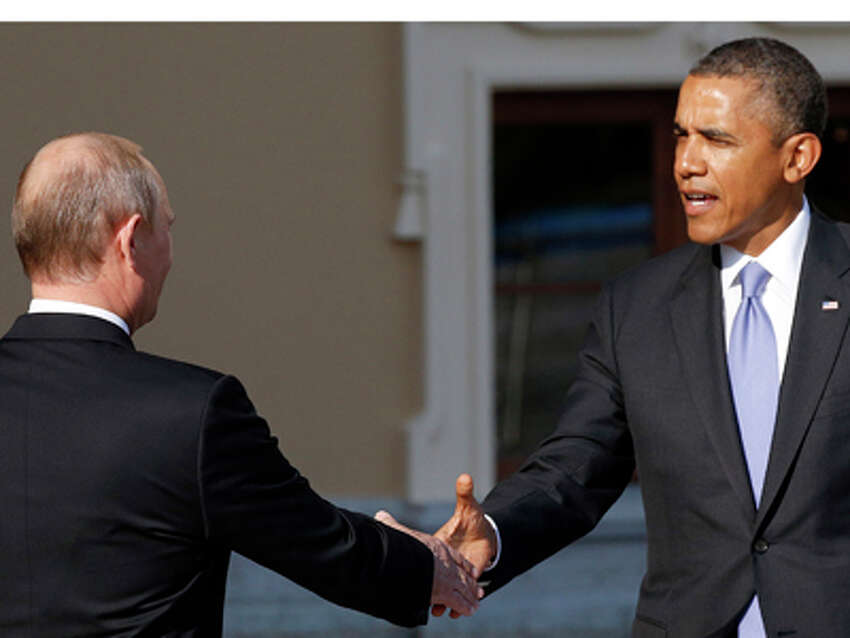 U.S. President Barack Obama, right, reaches out to shake hands with Russia's President Vladimir Putin during arrivals for the G-20 summit at the Konstantin Palace in St. Petersburg, Russia on Thursday, Sept. 5, 2013. The threat of missiles over the Mediterranean is weighing on world leaders meeting on the shores of the Baltic this week, and eclipsing economic battles that usually dominate when the G-20 world economies meet.