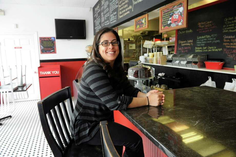 Jennifer Scaglione-Morris, the owner of My Favorite Place, sits at the longstanding outpost in Cos Cob on Sept. 5, 2013.  Photo: Helen Neafsey / Greenwich Time