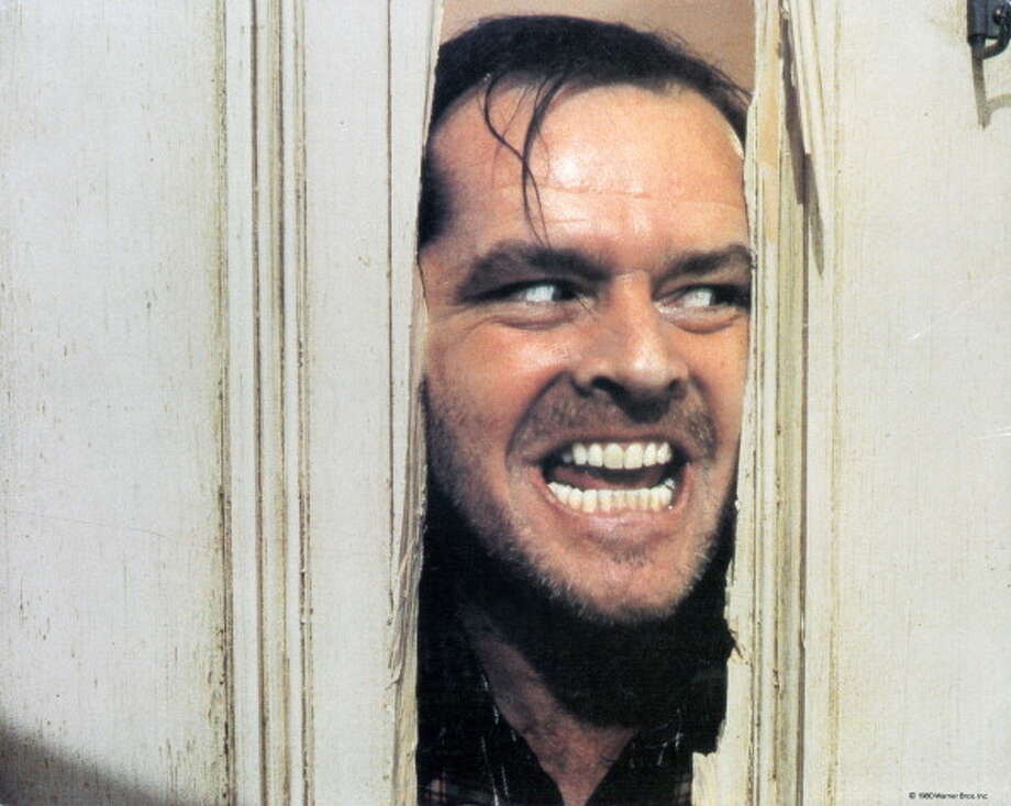Jack Nicholson peering through axed in door in lobby card for the film 'The Shining', 1980. (Photo by Warner Brothers/Getty Images) Photo: Archive Photos, Getty Images / 2012 Getty Images