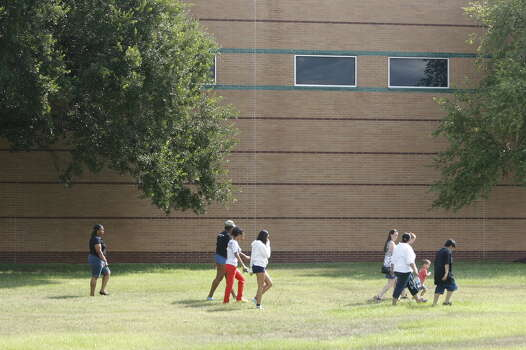 A group of parents and students walk away from Spring HS after being turned away at the front door. Some were asking for paperwork to transfer their children. The school said the paperwork was not available there. Photo: Johnny Hanson, Houston Chronicle