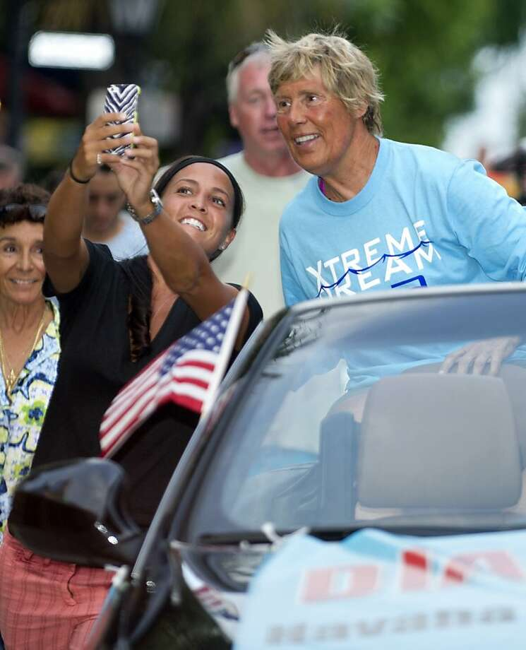 Diana Nyad views a photo on a fan's smartphone during a parade in Key West, Fla., a day after Nyad completed a Cuba-to-Key West swim. Photo: Rob O'Neal, Associated Press