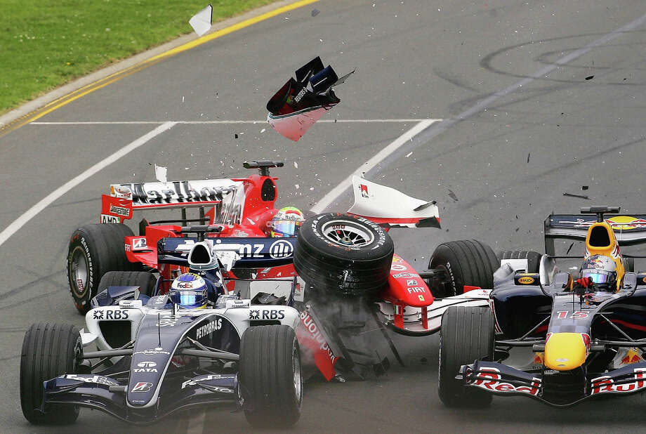 Felipe Massa of Brazil and the Ferrari Team crashes into Nico Rosberg of Germany and the Williams team during the Australian Formula One Grand Prix at the Albert Park Circuit on April 02, 2006 in Melbourne, Australia. Photo: Handout, Getty Images / 2006 Australian Grand Prix Corporation