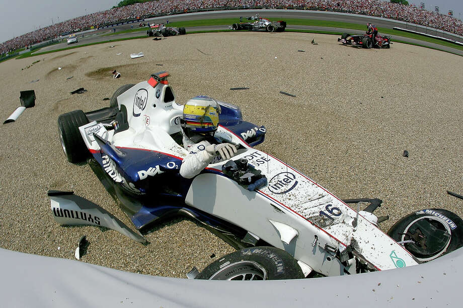 Nick Heidfeld of Germany and BMW Sauber gets out of his car after crashing on the first lap of the Formula One United States Grand Prix at Indianapolis Motor Speedway on July 2, 2006 in Indianapolis. Photo: Clive Rose, Getty Images / 2006 Getty Images