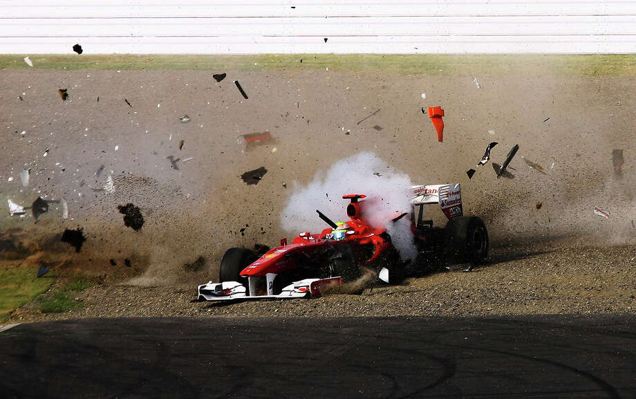 Felipe Massa of Brazil and Ferrari crashes at the first corner at the start of the Japanese Formula One Grand Prix at Suzuka Circuit on October 10, 2010 in Suzuka, Japan. Photo: Ker Robertson, Getty Images / 2010 Getty Images