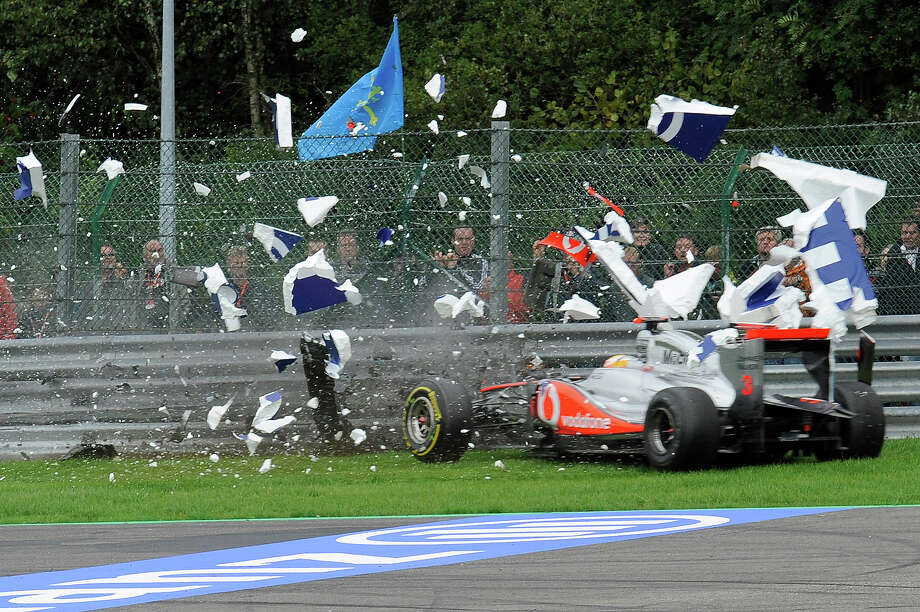 McLaren Mercedes' British driver Lewis Hamilton crashes at the Spa-Francorchamps circuit on August 28, 2011 in Spa during the Belgium Formula One Grand Prix. Photo: JOHN THYS, AFP/Getty Images / 2011 AFP
