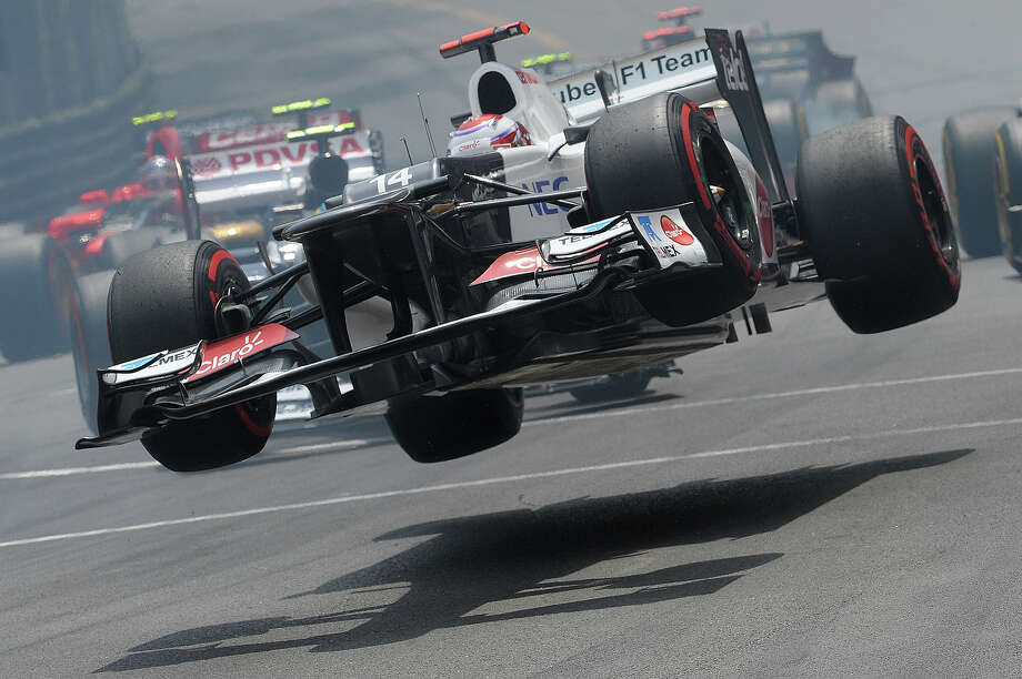 Sauber's Japanese driver Kamui Kobayashi crashes at the Circuit de Monaco on May 27, 2012 in Monte Carlo during the Monaco Formula One Grand Prix. Photo: TOM GANDOLFINI, AFP/Getty Images / 2012 AFP