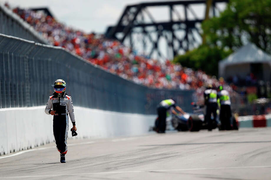 Pastor Maldonado of Venezuela and Williams walks back to the garage after crashing during qualifying for the Canadian Formula One Grand Prix at the Circuit Gilles Villeneuve on June 9, 2012 in Montreal, Canada. Photo: Vladimir Rys, Getty Images / 2012 Getty Images