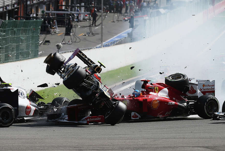 Romain Grosjean of France and Lotus is seen being catapulted into the air as he crashes at the first corner at the start of the Belgian Grand Prix at the Circuit of Spa Francorchamps on September 2, 2012 in Spa Francorchamps, Belgium. Photo: Mark Thompson, Getty Images / 2012 Getty Images