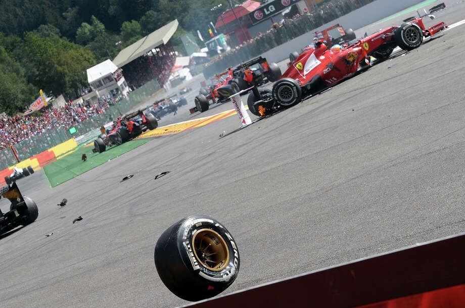 Ferrari's Spanish driver Fernando Alonso (L)  catches fire after crashing at the Spa-Francorchamps circuit on September 2, 2012 in Spa during the Belgium Formula One Grand Prix. Photo: TOM GANDOLFINI, AFP/Getty Images / 2012 AFP