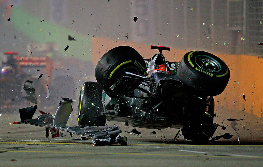 Michael Schumacher of Germany and Mercedes GP crashes with Jean-Eric Vergne of France and Scuderia Toro Rosso during the Formula One Grand Prix of Singapore at Marina Bay Street Circuit on September 23, 2012 in Singapore. Photo: Vladimir Rys Photography, Getty Images / 2012 Vladimir Rys