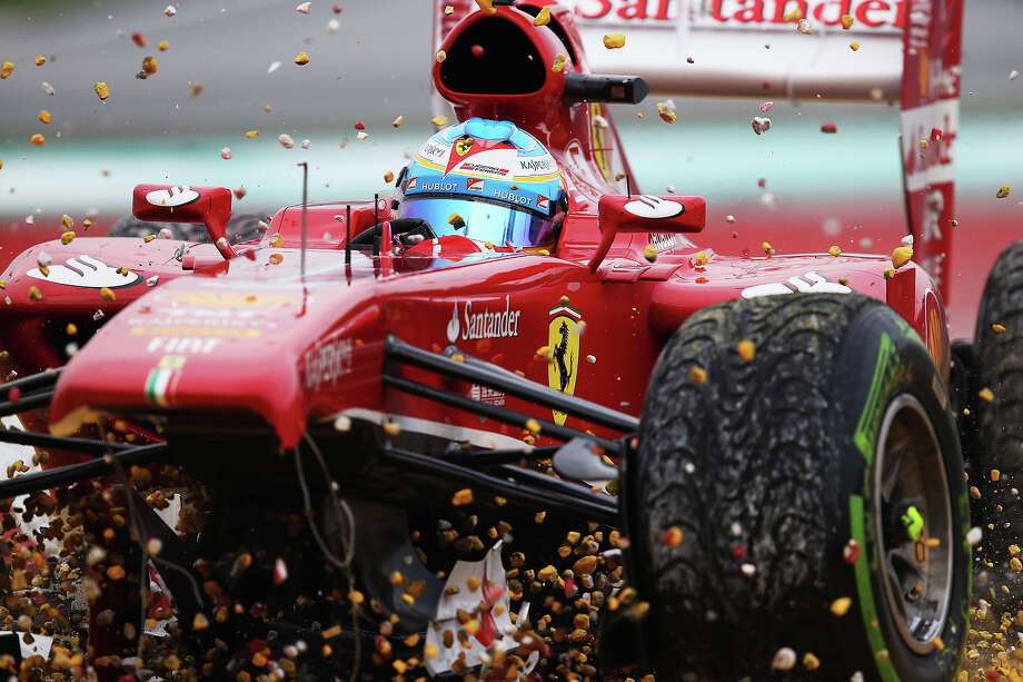 Fernando Alonso of Spain and Ferrari crashes into the gravel trap at turn one after sustaining front wing damage during the Malaysian Formula One Grand Prix at the Sepang Circuit on March 24, 2013 in Kuala Lumpur, Malaysia. Photo: Mark Thompson, Getty Images / 2013 Getty Images