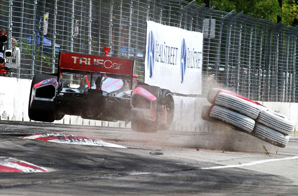 Sebastien Bourdais, of France, driver of the #7 Dragon Racing Chevrolet Dallara crashes into stack of tires as he exits the chicane during practice for the Grand Prix of Baltimore on August 31, 2013 in Baltimore.