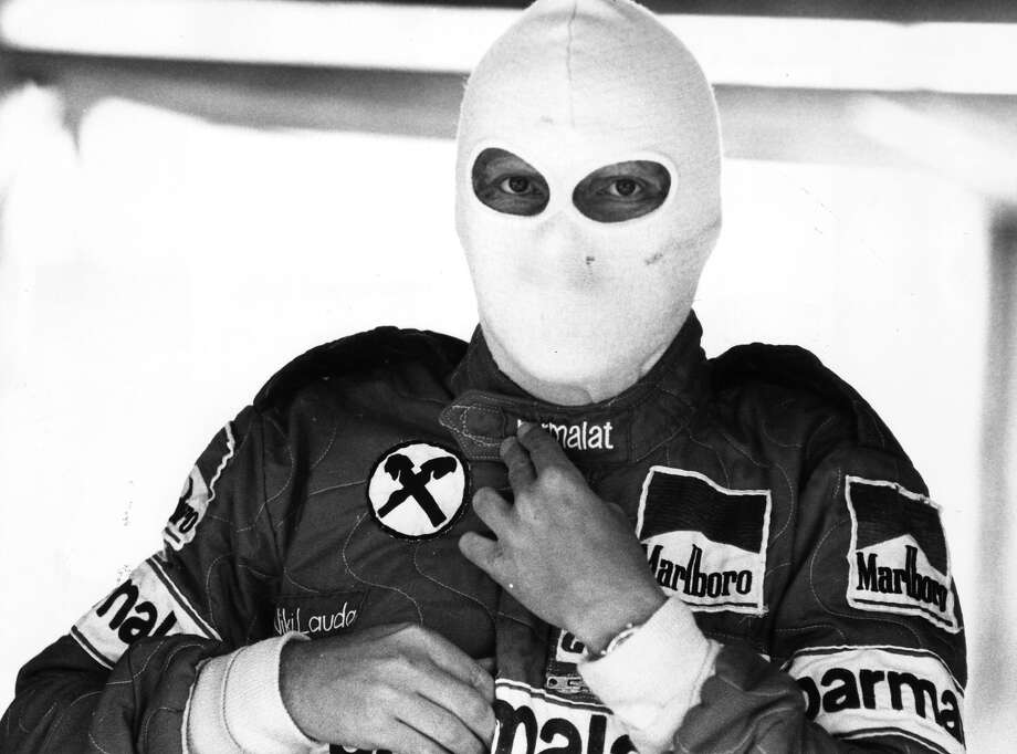 Niki Lauda wearing a protective face mask before a practice run at Brands Hatch, England. Photo: Rob Taggart, Getty Images / Hulton Archive