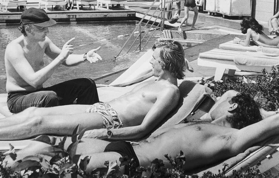 Austrian racing driver Niki Lauda with his English rival James Hunt chatting by the swimming pool of the Sheraton Hotel the following year. Photo: Keystone, Getty Images / 2005 Getty Images