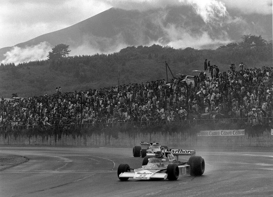 Hunt  drives the #11 Marlboro Team McLaren McLaren M23 Ford Cosworth V8 through the rain and with Mount Fuji in the background during the Japanese Grand Prix. Photo: Grand Prix Photo, Getty Images / 2012 Grand Prix Photo