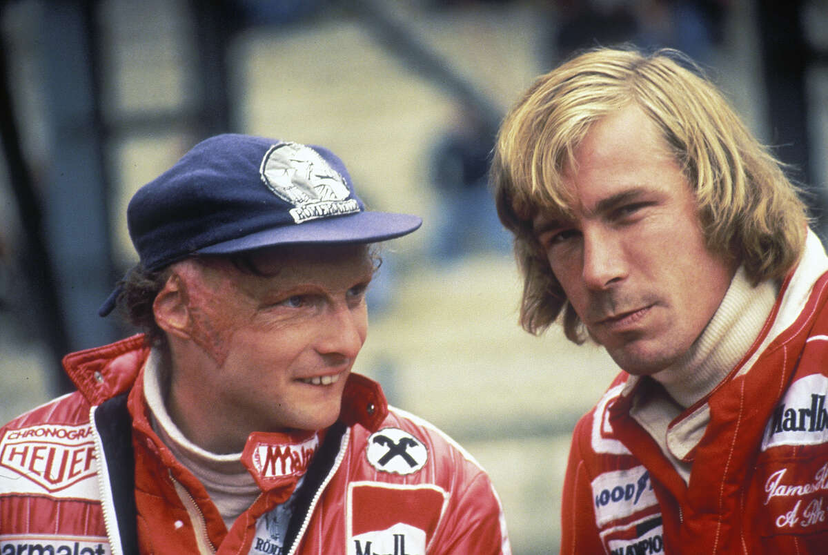 Luada was badly burned in a crash at Nürburgring but came back to race in the same season, battling John Hunt, right, for the championship.