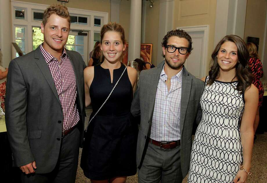 Saratoga Springs, NY - August 23, 2013 - (Photo by Joe Putrock/Special to the Times Union) - (l to r)Mike Krasodomski, Nicole Borisenok, Michael Borisenok and Emily Greer during the 15th Annual Travers Wine Tasting to benefit Senior Services of Albany. ORG XMIT: 03 Photo: Joe Putrock / Joe Putrock
