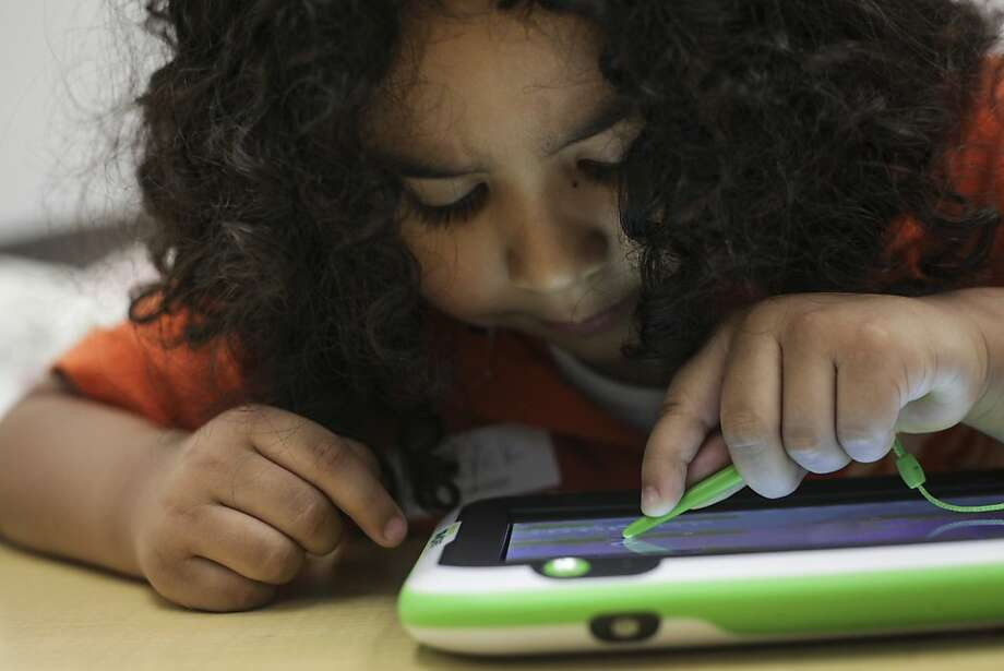 Erick Gaytan tests a new game on the newly released LeapPad Ultra in the Kid Lab at LeapFrog's Emeryville offices. Photo: Sam Wolson, Special To The Chronicle