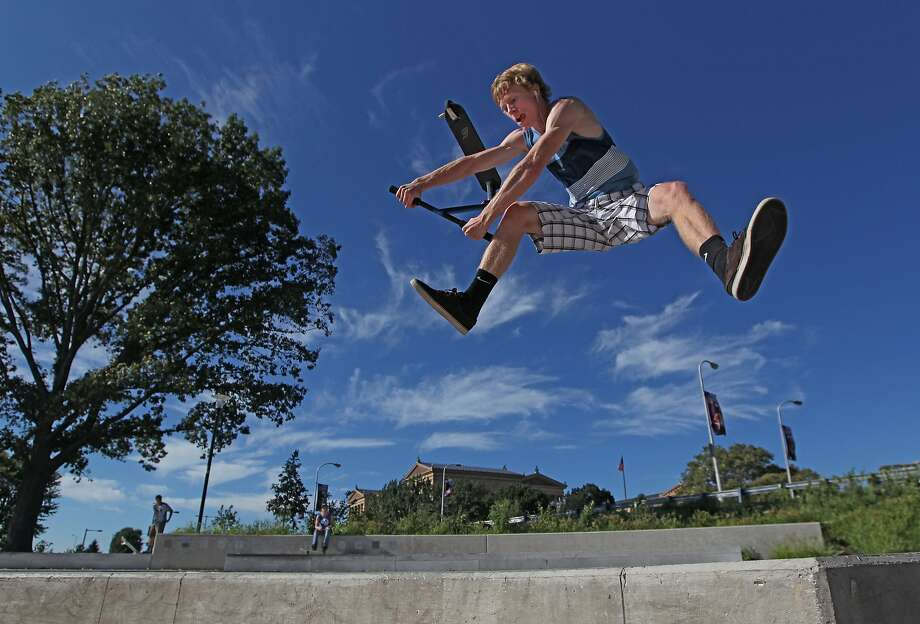 """If we relaxed like that, we'd break our legs:According to the AP caption, """"Sean Quigley,   16, of New Jersey decided to relax after his first day of high school by doing acrobatic   tricks on his scooter"""" near the Philadelphia Museum of Art. Photo: Michael Bryant, Associated Press"""