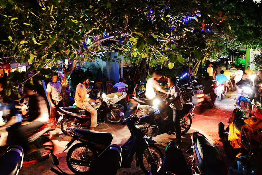 Scoot city:In Male, the capital of the island nation of Maldives, mopeds are the most popular mode of   transportation. Photo: Roberto Schmidt, AFP/Getty Images