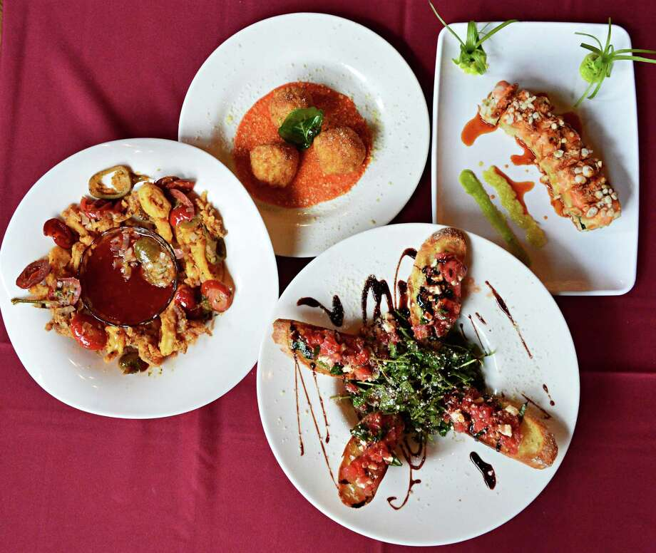 Appetizers, from left, Calamari Louie, Arancini, bruschetta, and a crunchy shrimp roll at Carney's Tavern Saturday Aug. 31, 2013, in Ballston Lake, NY.  (John Carl D'Annibale / Times Union) Photo: John Carl D'Annibale / 00023707A