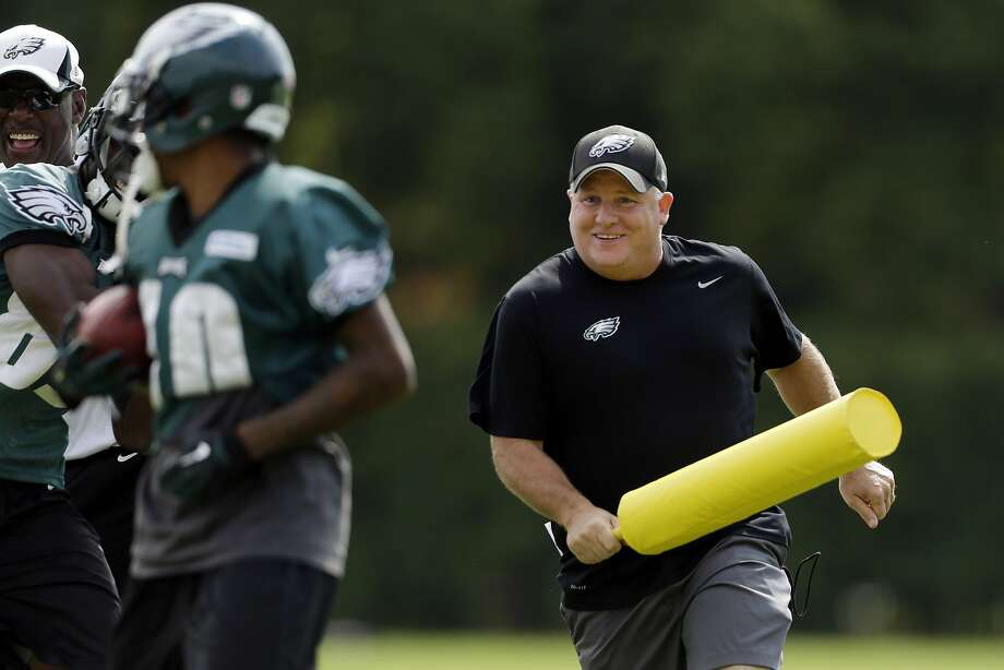 "Motivational tool: When new Philadelphia Eagles head coach Chip Kelly doesn't think his players are working hard enough, he comes after them with a yellow bat. And by ""players,"" we mean you, DeSean Jackson. Photo: Matt Rourke, Associated Press"